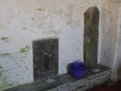 Tintagel: stone bench, Roman pillar and C14 brass
