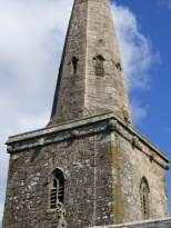 St Hilary: the tower carvings